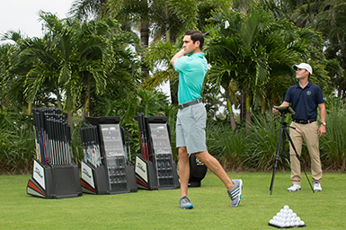 A golfer receives private instruction at the John Webster Golf Academy