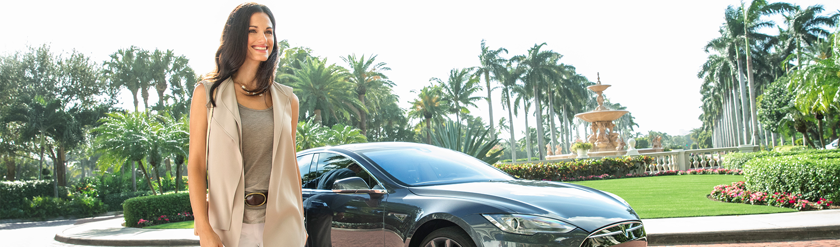 A guest arrives at The Breakers in Flagler Club's chauffeured Tesla house car