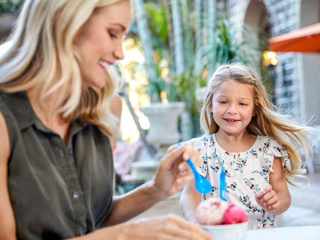 A parent and child enjoy ice cream from Mary Lily's at The Breakers