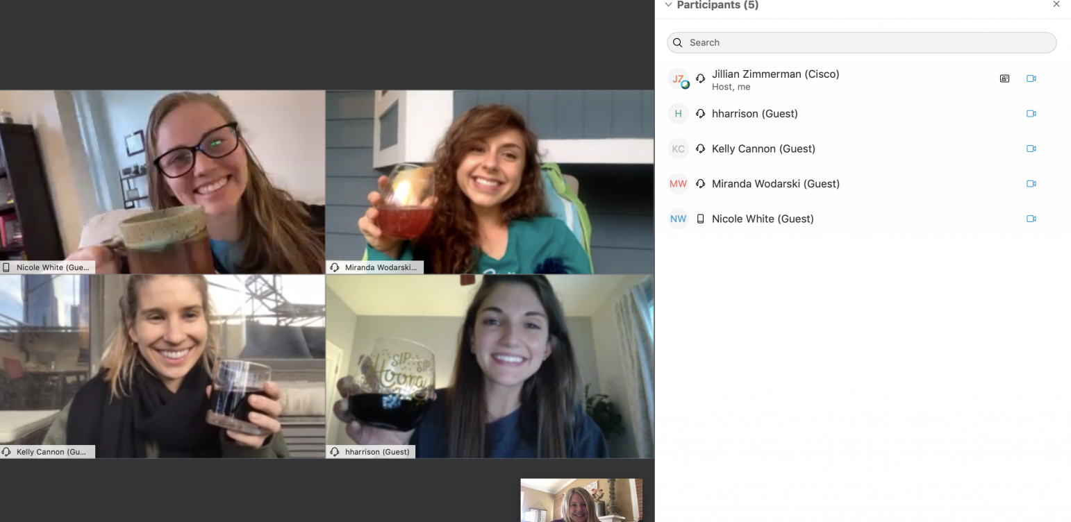 3 tips for managing a virtual get together. A group of friends hanging out and drinking wine. Four young women in the webex meetings space. Wine glasses are put in the air to toast.