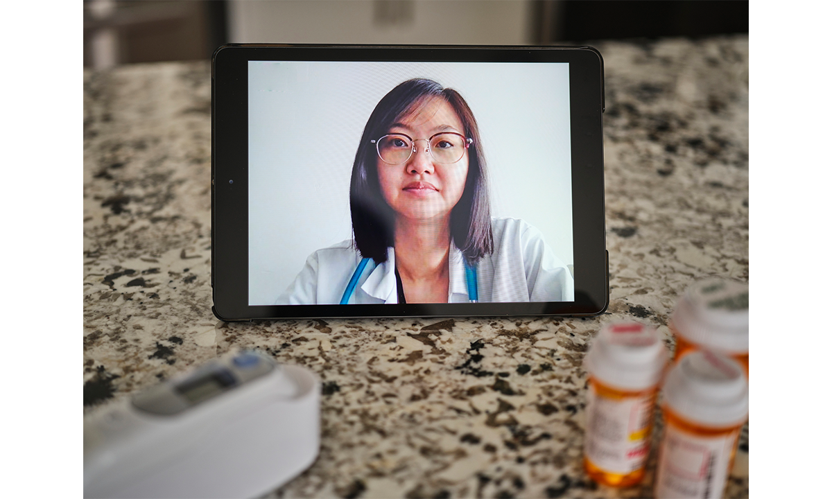 Microsoft + Cisco . A telemedicine appointment with a doctor online.