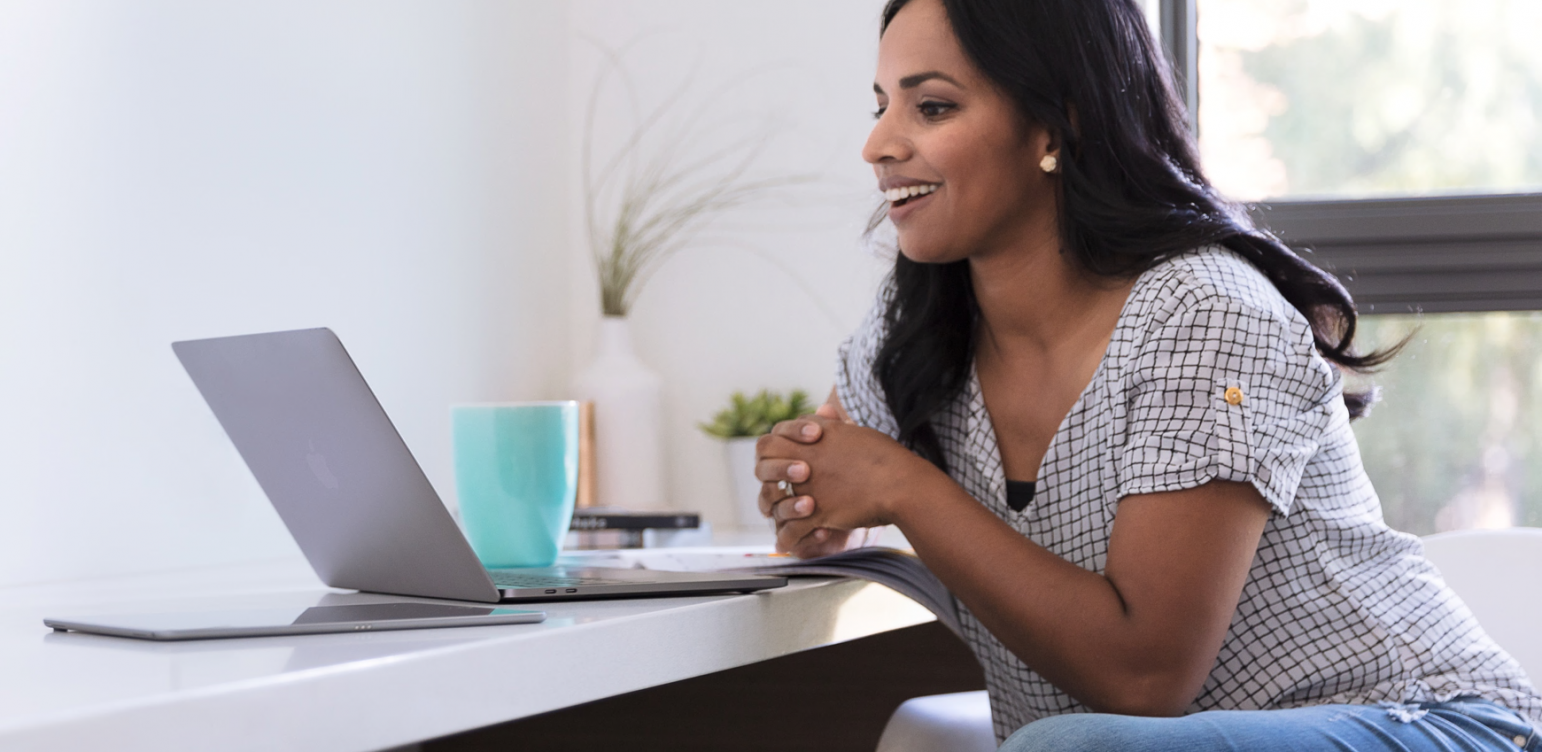 Woman sitting in front of computer working remotely