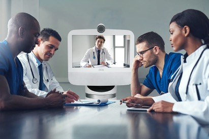 Ava Robotics and doctors sitting at a table