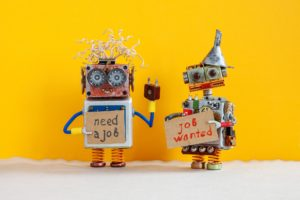 Job search concept. Two robots wants to get a job. Smiley unemployed robotic characters with a