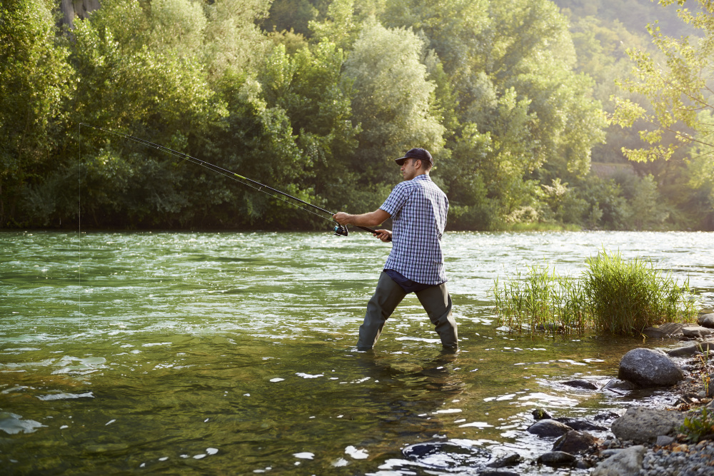 Man fly fishing without neck pain
