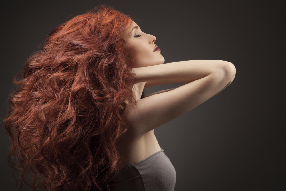 Woman with long red curly hair