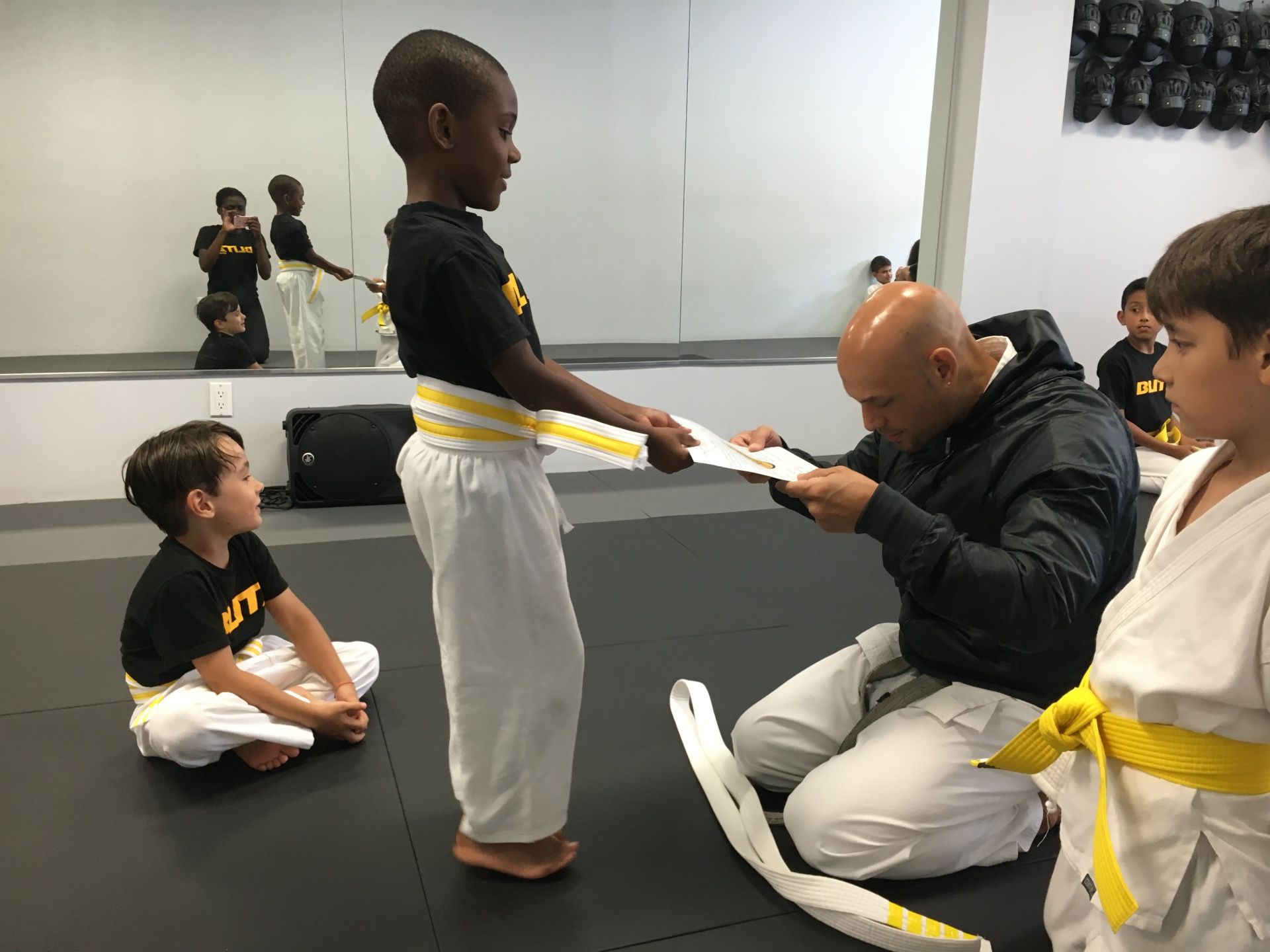 A Lil Lion receiving his first belt!