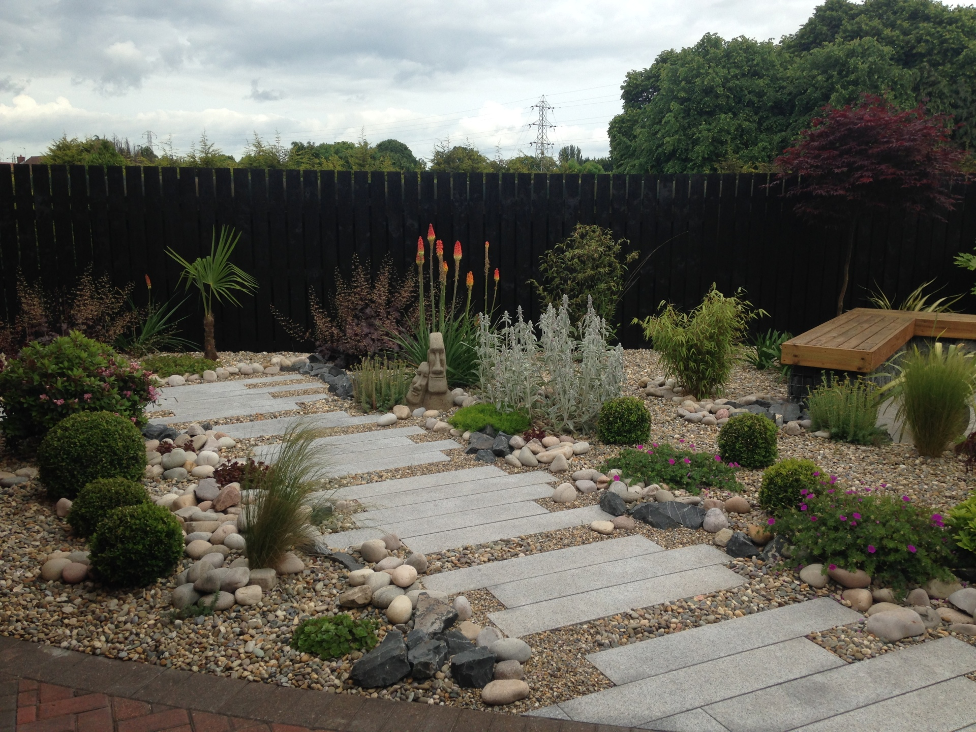 A feature pathway constructed using silver grey granite plank paving.