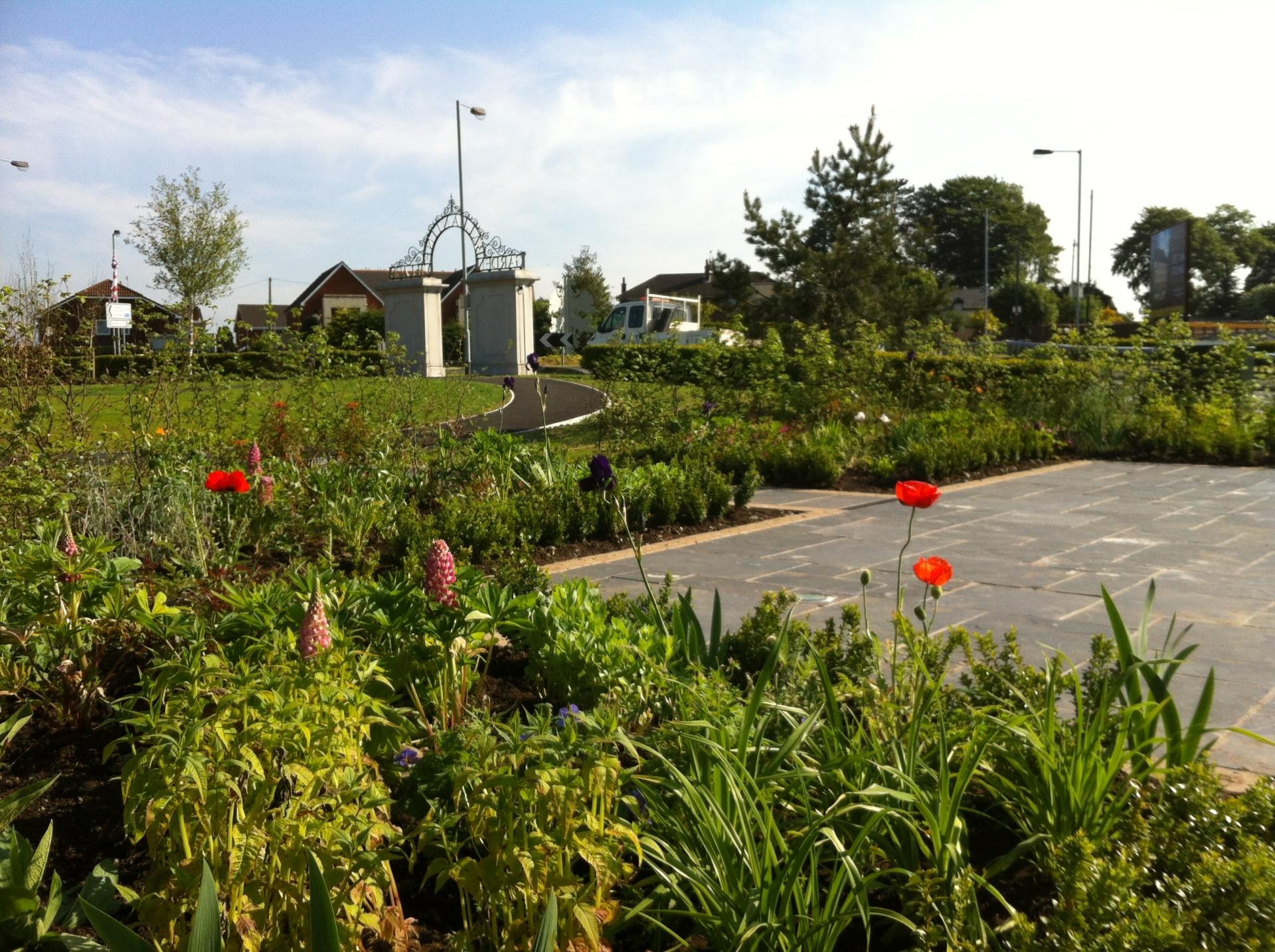 Ballantine Garden Village, black limestone paving, buxus hedging