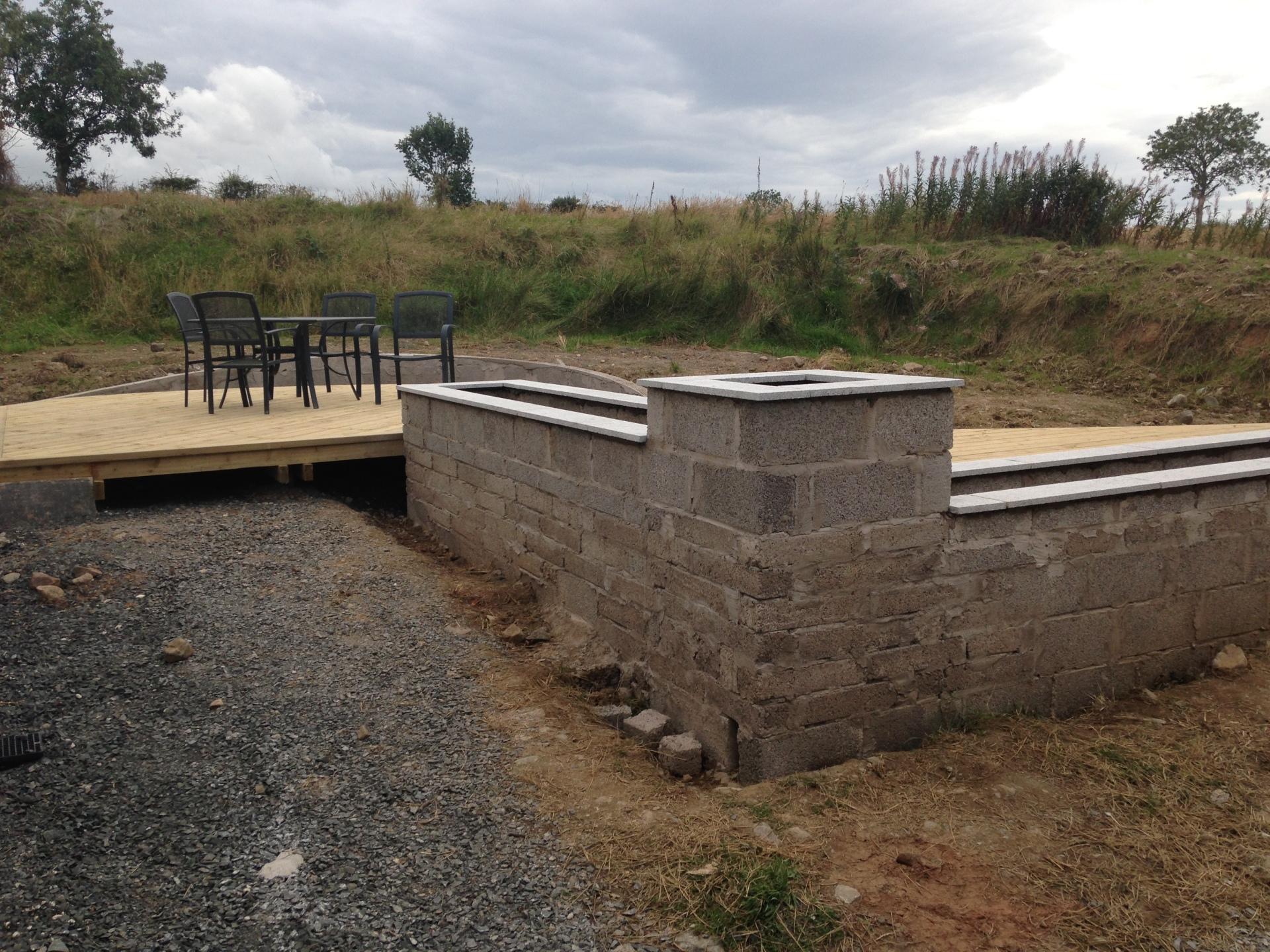 raised planter, silver grey granite, concrete block