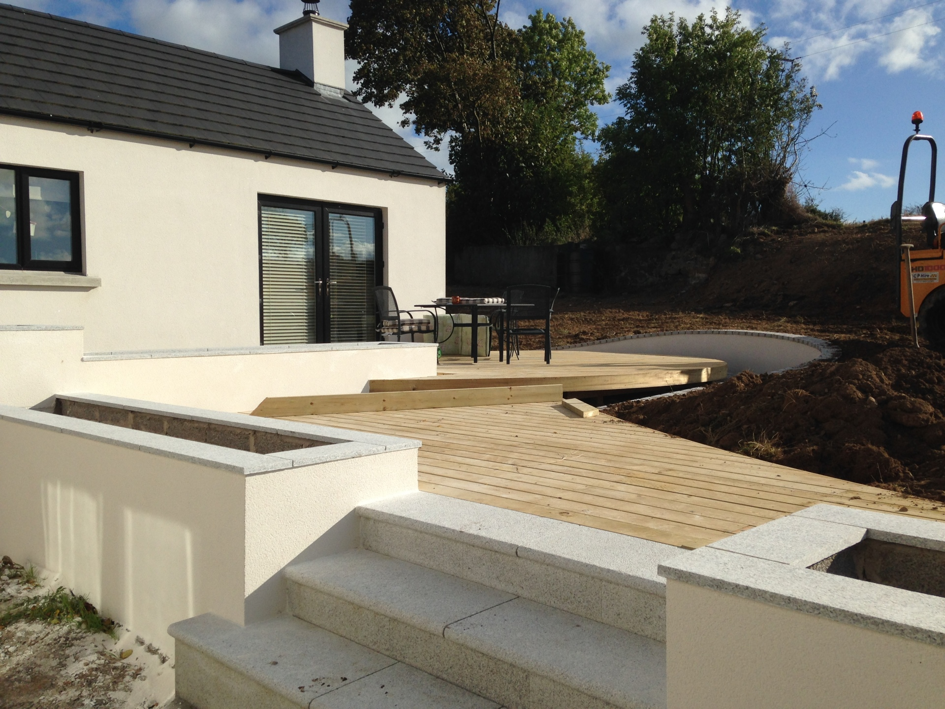 Curved timber deck, K-Rend, raised planters