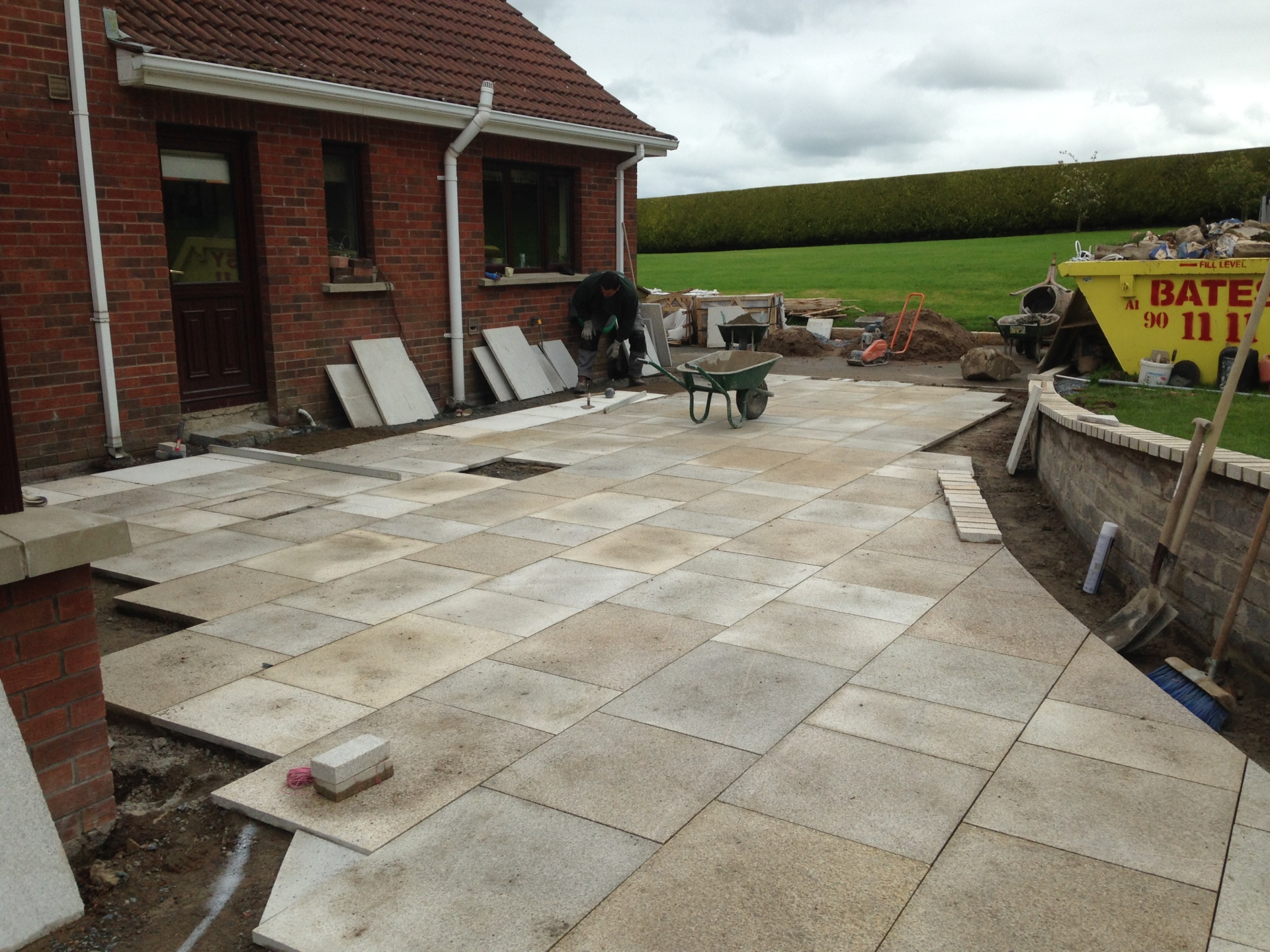 Laying yellow granite paving