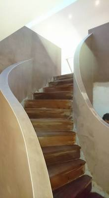 curved staircase plastered