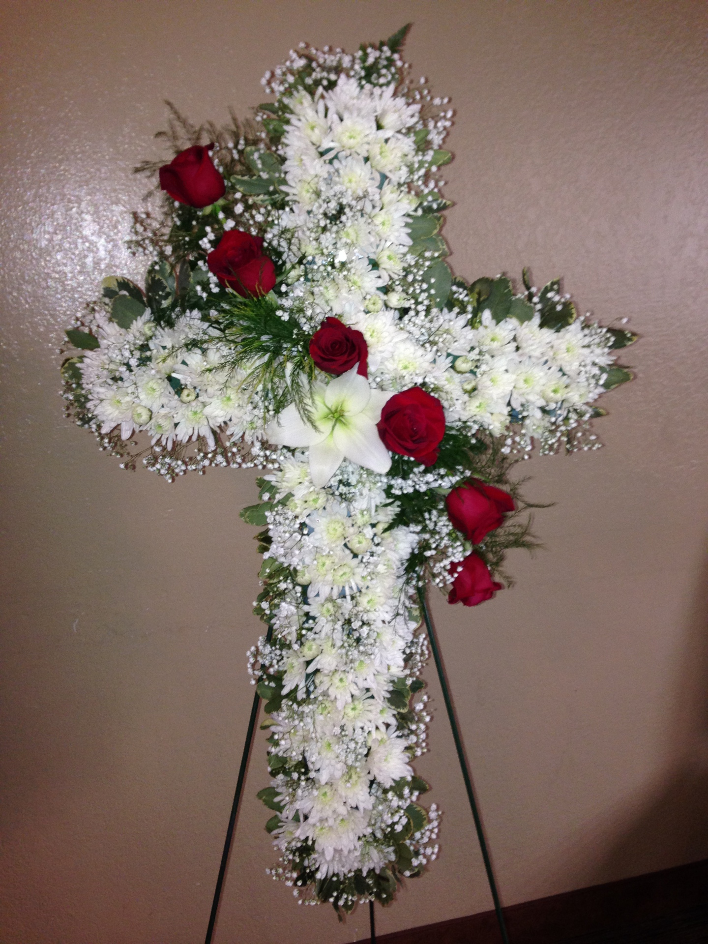 white cross red roses