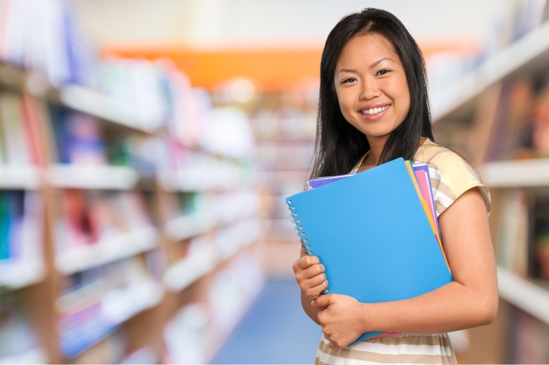 Girl holding folders