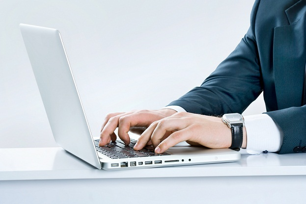 Image of a laptop with male hands