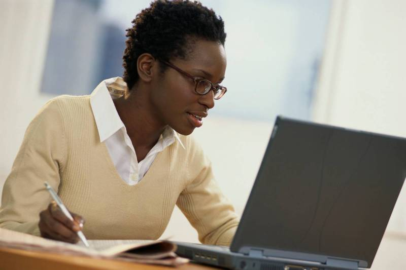 Image of girl working on laptop