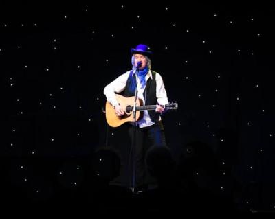 Chris Golden, Entertainer singing at Dugger Mountain Music Hall