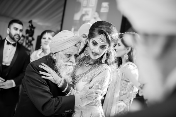 black and white photo of bride and grandad embracing