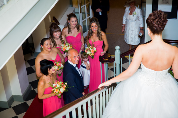 bride walking down the stairs to her father