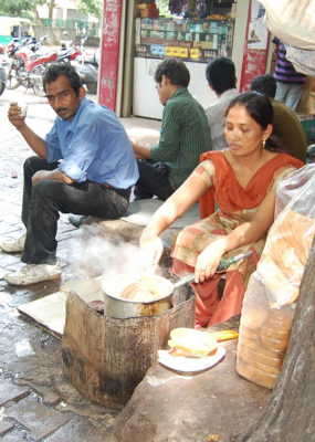 #696 -  WOMAN MAKING TEA