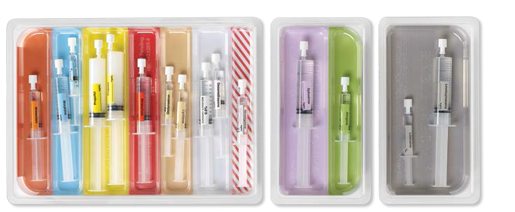 Rainbow trays loaded with drawn up syringes
