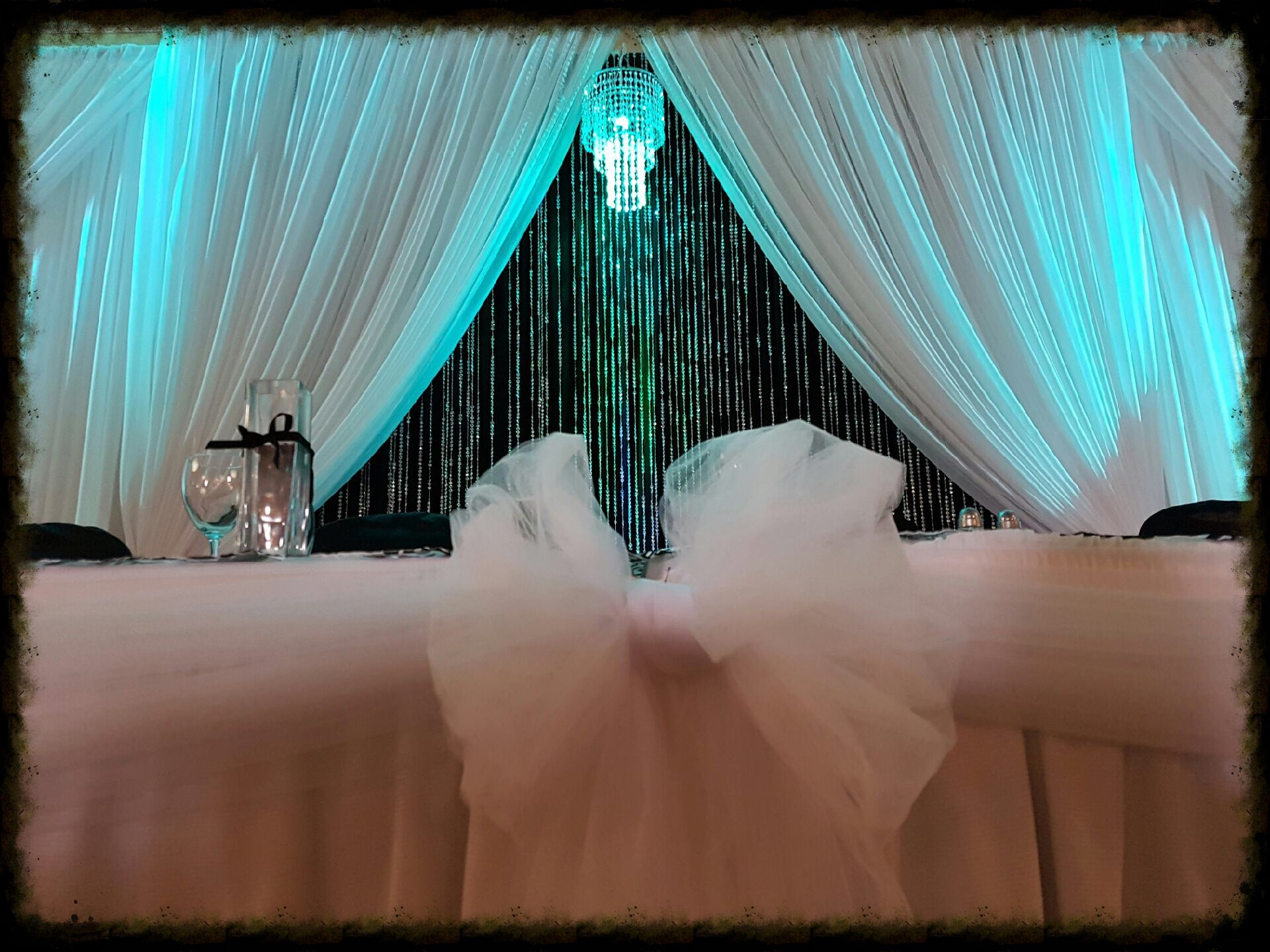 Backdrop with black curtains and beads