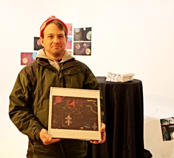 Artist Jeff Mendenhall with his piece, Into Space