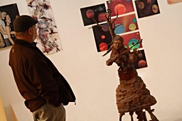 Artist Ken Hogrefe checking out the art