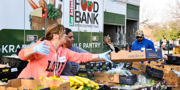 Photo of volunteers at an american opportunity for housing food drive - by luis ramirez web print photography
