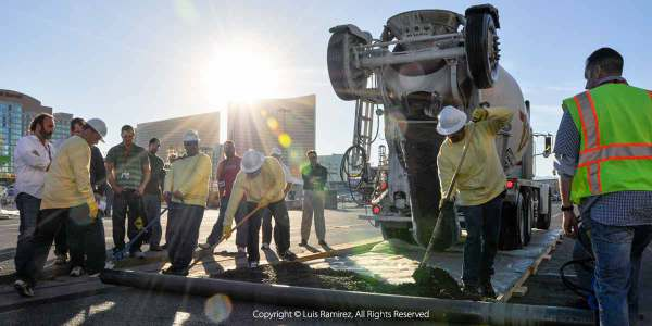 photo of working crew pouring concrete at the concrete world in las vegas nevada - luis ramirez web print photography