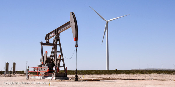photo of oil well and wind energy tower in texas by luis ramirez