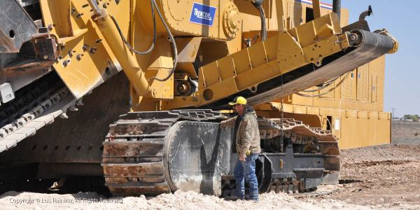 trencher at oil well - midland texas - by luis ramirez web print photography