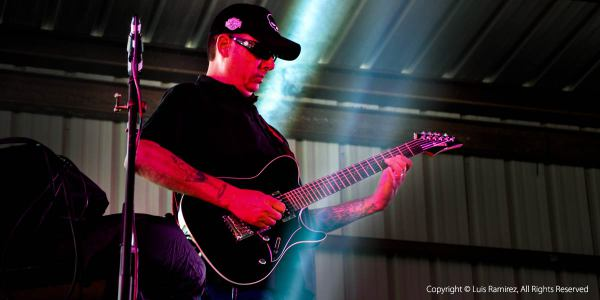 photo of guitar player at the EMS fundraiser event in blanco texas - by luis ramirez web print photography