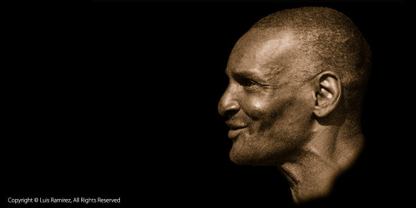 Photo of a man sepia colored on black background by luis ramirez