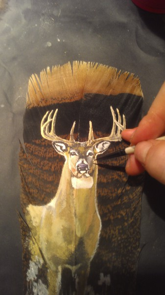 Painting the detail on a tail feather from Michigan!