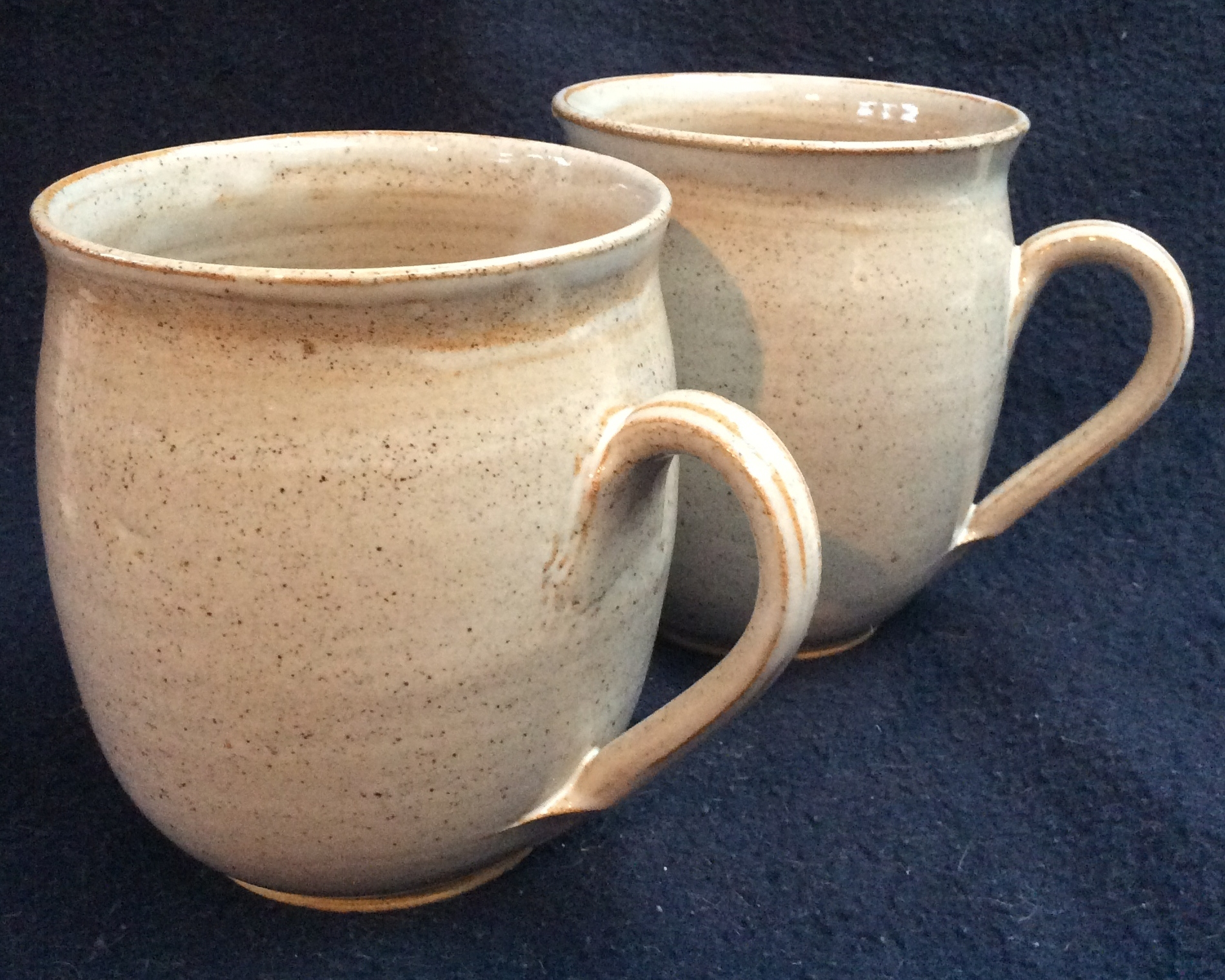 hand-thrown mugs  white glaze
