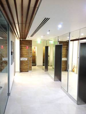 Timber wall panelling|sandstone features|artwork|Australian Commercial Interiors