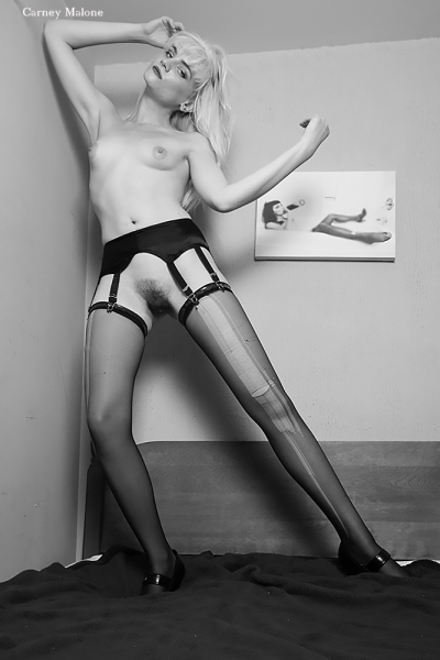 Nude Wearing Garter Belt