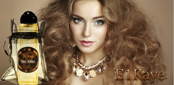 A white women with big curly light brow hair holding a bottle of E1Kaye perfume by Dior