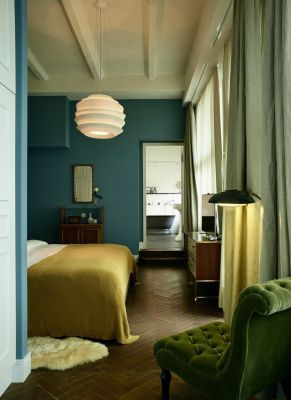Stunning bedroom using blue-greens, greens and golds