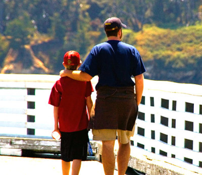 Kelly Jarrell Family Success, view of father and son walking together