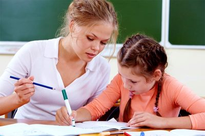 Kelly Jarrell Family Success, view of tutor working with a young girl student