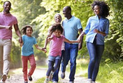 kelly jarrell family success, view of happy african american family running holding hands