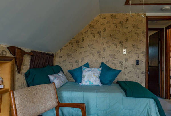 The front bedroom has two beds and access to a full bathroom upstairs.