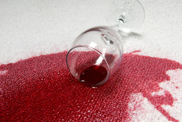 Picture of red wine that has spilt on white carpet