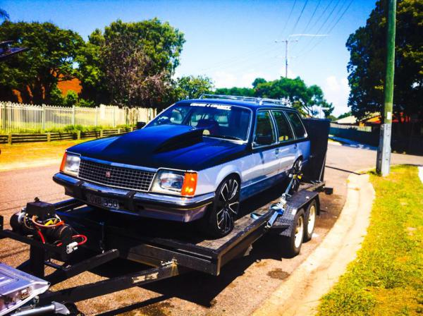 Cheap Towing Service Ipswich Towing - Holden Commodore Wagon - Tilt Tray Towing.jpg