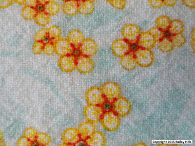 Close up of small flower design digitally printed on woven wool by faering ltd