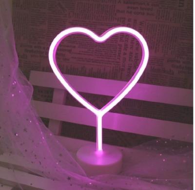 pink love heart neon light