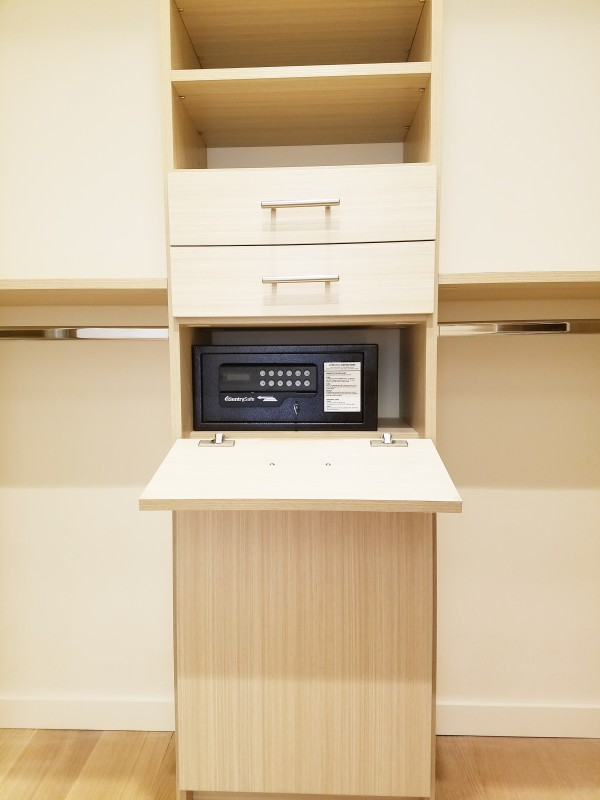 Compact safe integrated into a closet design